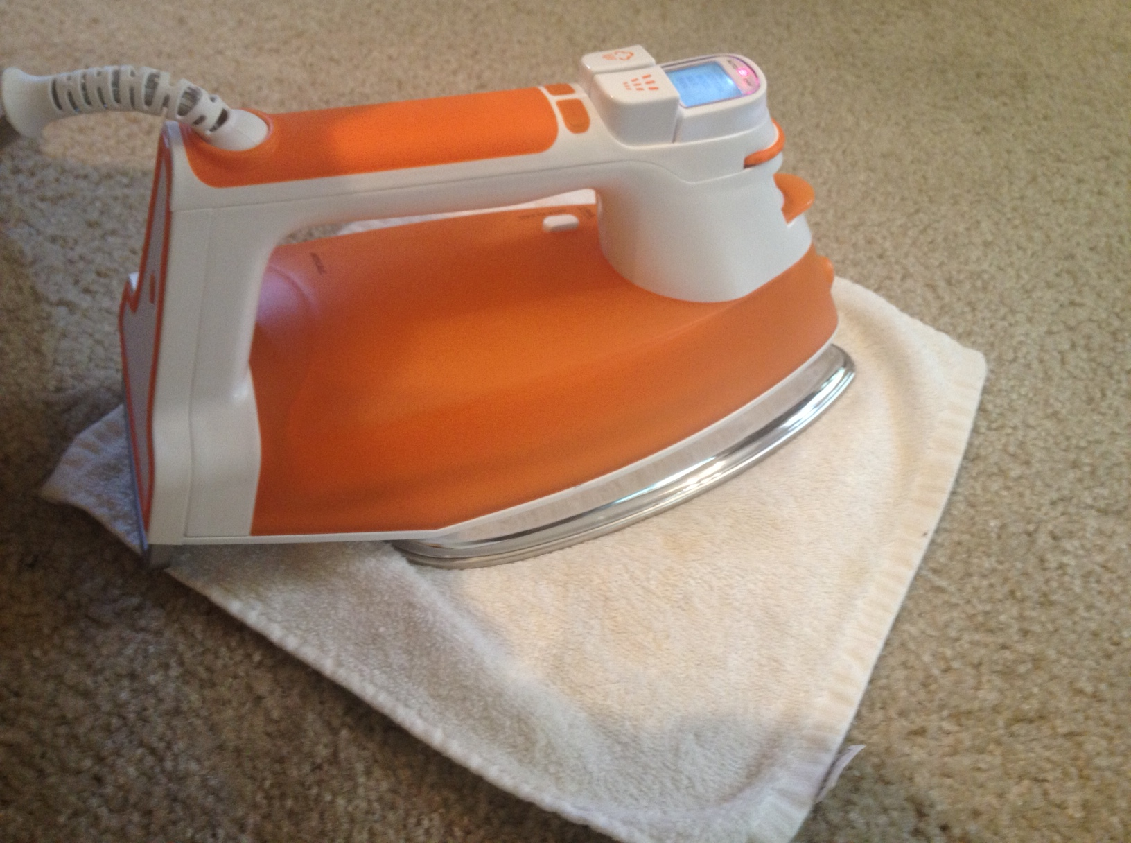 How To Clean Stubborn Carpet Stains With An Iron And