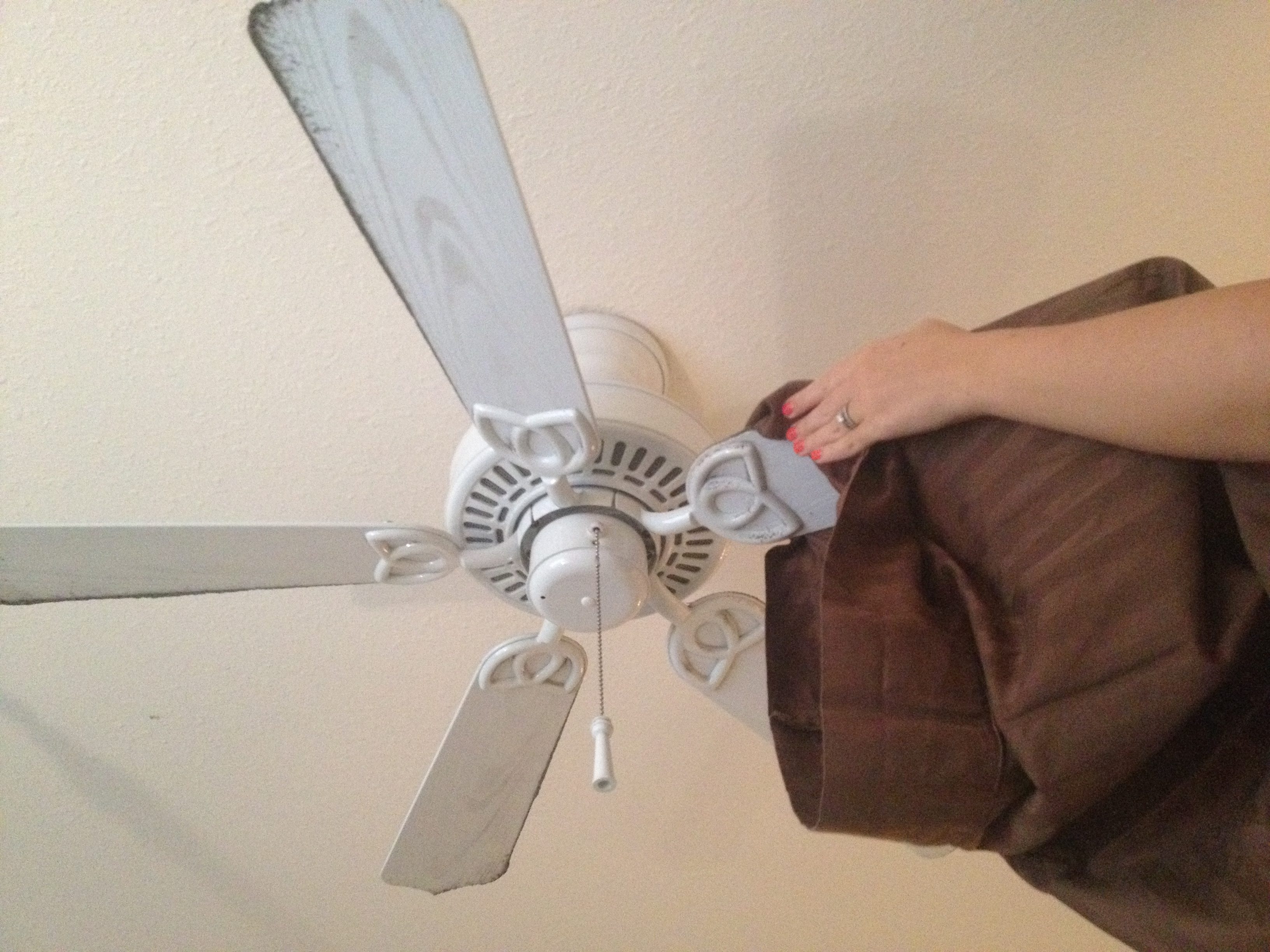 How to clean fan blades without a dusty mess homemaker chic use a pillow case to clean fan blades homemakerchic mozeypictures Choice Image