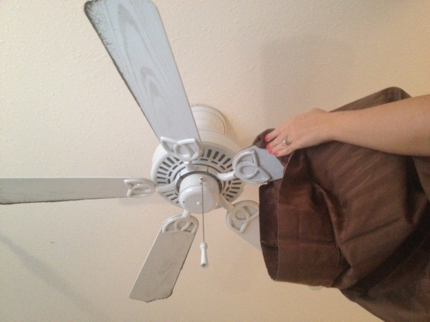 Use a pillow case to clean fan blades homemakerchic.com